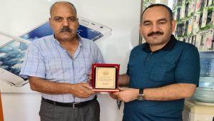 Başkan Teke'den Gazete Kahta'ya plaket